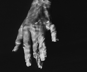 water, black and white, and hand image