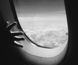 airplane, black and white, and clouds image