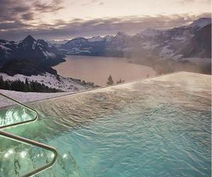 pool, mountains, and snow image