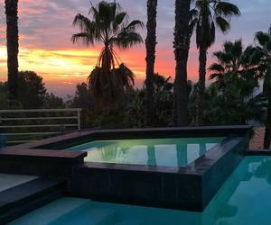 pool, luxury, and sunset image