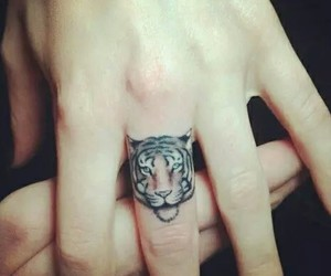 hand, ink, and tiger image