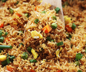 carrots, fried rice, and peas image