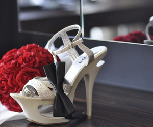 red roses, wedding shoes, and hand bouquet image