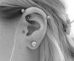 black and white, Piercings, and ear piercings image