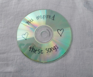 cd, music, and song image