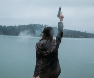 girl, gun, and lake image