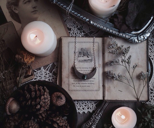 book, candle, and witchcraft image