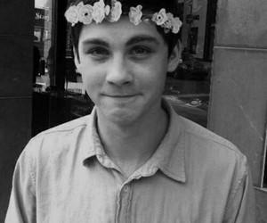 logan lerman, boy, and flowers image