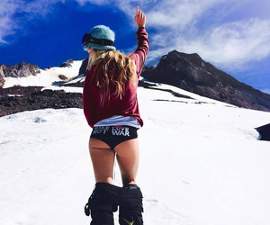 girl, snow, and snowboarding image