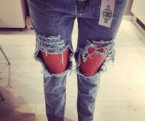fashion and distressed jeans image