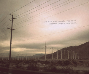 wind mill, text, and telephone lines image