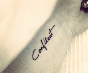 tattoo and confident image