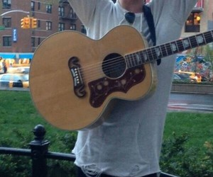 Jamie Campbell Bower and guitar image