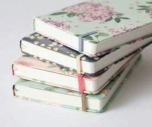 books, notebook, and flowers image