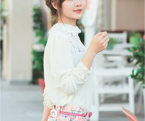 bangs, blouse, and bun image