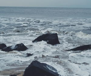 beach, rocks, and waves image