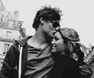 couple, douglas booth, and miley cyrus image