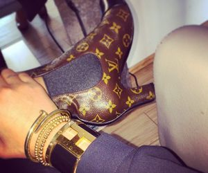 bangle, boots, and heels image