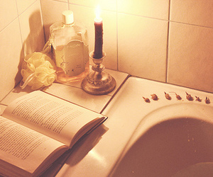 book, candle, and bath image