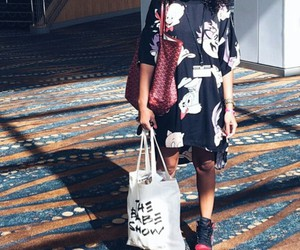 silver hoops, white tote bag, and cartoon t-shirt image