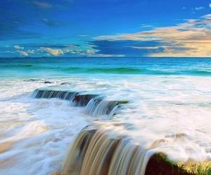 sea, waterfall, and beach image