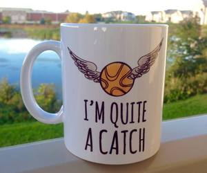 golden snitch and harry potter image