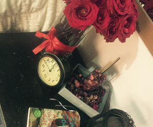 book, flowers, and watch image