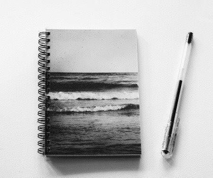 sea, notebook, and pen image