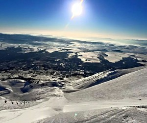 Skiing, sun, and view image