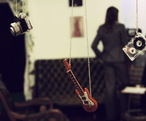 guitar and necklace image