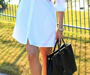 black purse, gold watch, and white shirtdress image