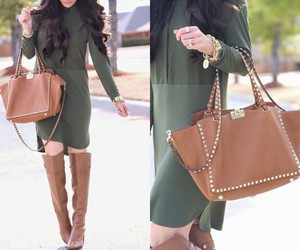 silver ring, studded purse, and gold bracelets image