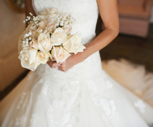 wedding dress, bride, and flowers image