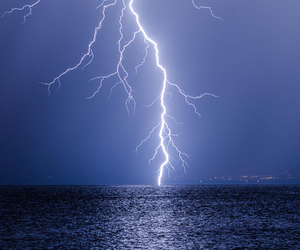 ocean, storm, and lightning image