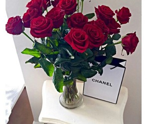 red roses and chanel shopping bag image