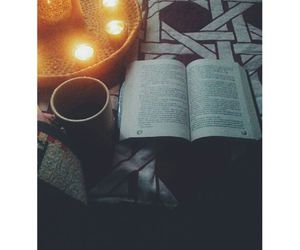 bed, candle, and book image