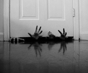 hands, door, and grunge image