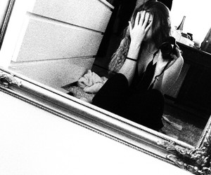 black, black and white, and mirror image