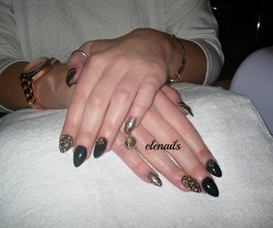 leopard, nails, and rings image