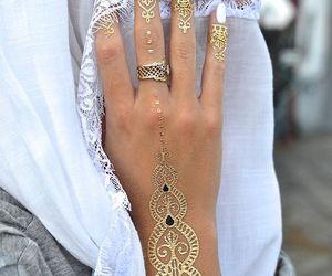 henna, gold, and tattoo image