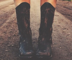 cowboy boots and dirt road image