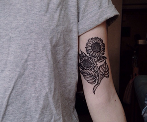 black, daisies, and sunflower image