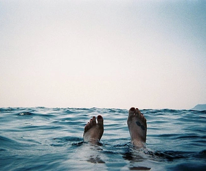 sea, feet, and water image