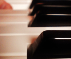 hand, piano, and music image