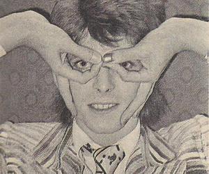 david bowie, hands, and illuminati image