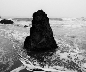beach, rock, and black and white image