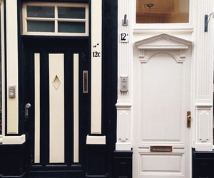 doors, black and white, and architecture image