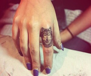 finger, wolf, and tattoo image