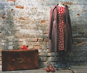 coat, shoes, and suitcase image