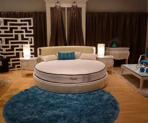 contemporary bedroom, beige round bed, and elegant blue fur rag image